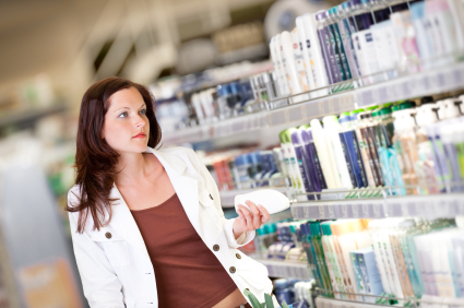 Shopping series - Young woman holding shampoo