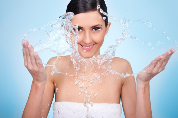 woman wash her face with water