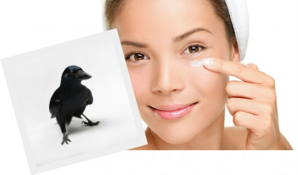 Everyone's favourite stock model applies eyecream while a crow looks on.  As they do.