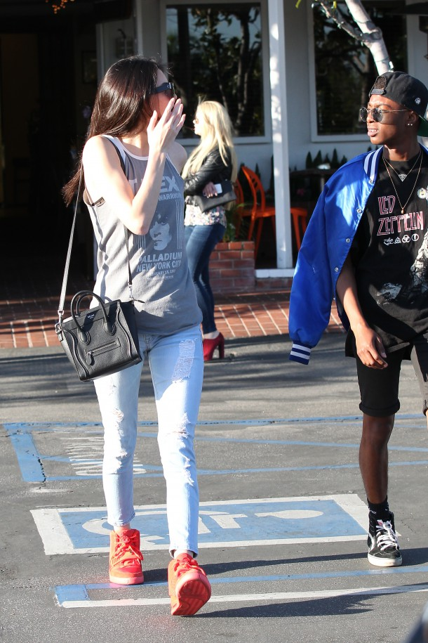 Kendall Jenner and a friend leaving Cafe Mauro at Fred Segal on Melrose in west Hollywood. She Drove away in her blacked out Range Rover Sport