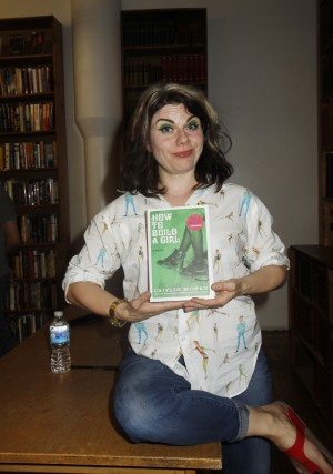 British writer Caitlin Moran who has been compared to US writer and actress Lena Dunham shocked her audience by pulling up her blouse and showing her huge belly fat and commenting on men's penis size during a reading of her book, 'How to Build a Girl' Featuring: Caitlin Moran Where: New York, New York, United States When: 07 Jul 2015 Credit: Michael Carpenter/WENN.com **Not available for New York Daily News.**