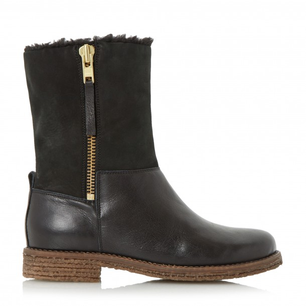 A good flat boot to keep you comfortable, and your feet dry! These ones are from Dune, €160