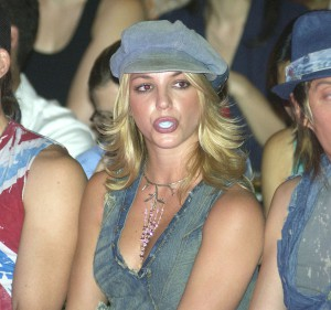 NEW YORK - SEPTEMBER 22: Singer Britney Spears blows bubbles with her bubble gum during the House of Field Spring/Summer 2003 Collection at the New York Public Library during the Mercedes-Benz Fashion Week on September 22, 2002 in New York City. (Photo by Mark Mainz/Getty Images)
