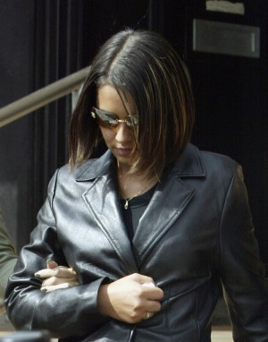 GUILDFORD, SURREY - JULY 11: Girls Aloud singer Cheryl Tweedy leaves Guildford Crown Court on July 11, 2003 in Guildford, Surrey. Tweedy is appearing on a charge of assault on the 11th January 2003 involving Sophie Amogbokpa. (Photo by Matt Smith/Getty Images)
