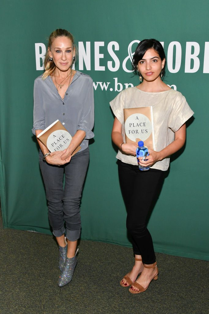 Sarah Jessica Parker (L) and Fatima Farheen Mirza attend Fatima Farheen Mirza in conversation with Sarah Jessica Parker holding copies of novel A Place for Us