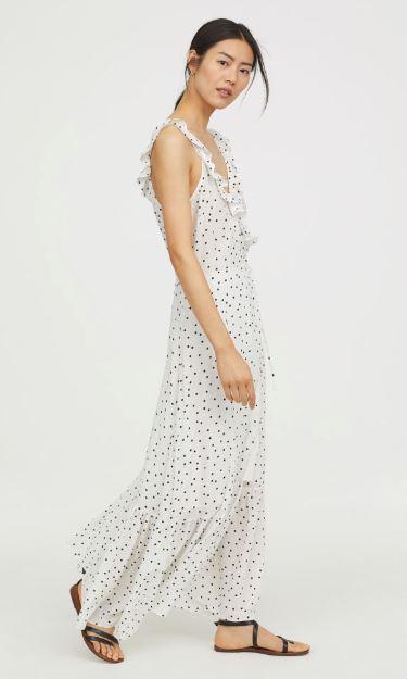 model wearing maxi length white dot dress