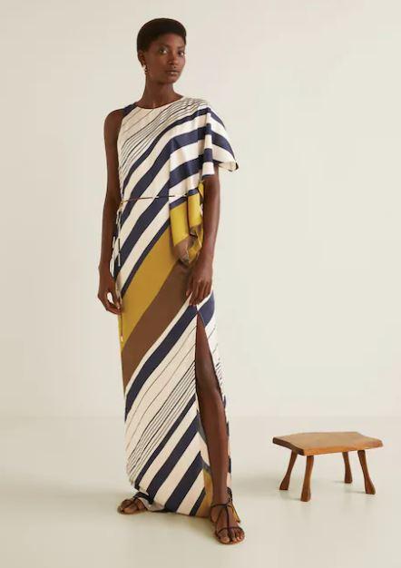 model wearing floor length asymmetrical dress from mango
