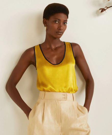 model wearing mango's mixed flowy top