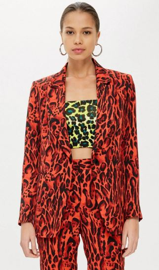 model wearing a red leopard print jacket